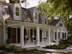 I MUST have a huge back porch...rocking chairs, swing, etc.  And the black & white coloring with the brick red door isn't too bad either ;)