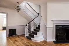 Traditional painted timber staircase with french polished handrail. Timber panelling up the side of the staircase and traditional black radiator. Timber Staircase, Stairs, Black Radiators, Lawrence Street, Architects London, Polished Plaster, Traditional Staircase, Timber Panelling, Residential Architect