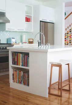 Building bookshelves into kitchen counters is so handy and a great space saver