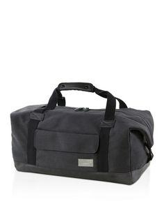 Eastpak Denim Stand + Topped Waxed shell Duffle Bag in Black
