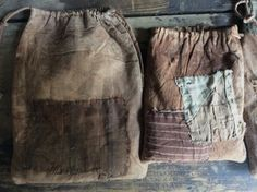 Primitive seed bags. 1. hand dyed brown old feed sack textile with old brown…
