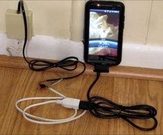 How to charge your cell phone off your land line if the power is out. photo credit DIYHacksAndHowTos