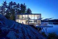 A photographer's studio over a boathouse on Stoney Lake is inspired by the landscape of the Canadian Shield.