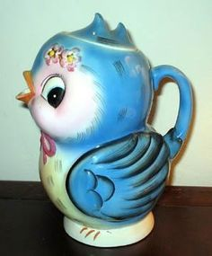 This is a rare Lefton China Bluebird Musical Teapot. Not normally numbered as they have a music movement in the bottom.