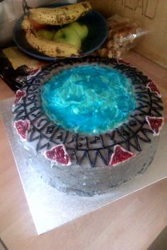 Stargate cake (not a fan of the show, but that electric blue is stunning and the symbol making took dedication!)