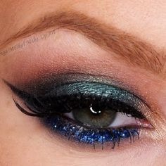 This Arabian inspired eye makeup features some gorgeous blue glitters for accent. Learn the essentials needed to recreate this look for your next night-out.