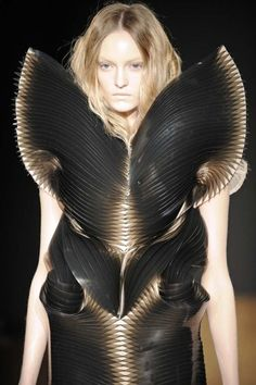 Sculptural Fashion - tactile, 3D layered contours; wearable art; alien-like dress form; futuristic fashion // Iris van Herpen SS11