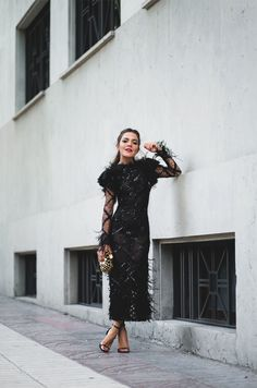 Bazaar 150. Black laced feathers long dress+black ankle strap heeled sandals+gold and black pearl clutch+gold earrings. Summer Evening Semi Formal Event Outfit 2017