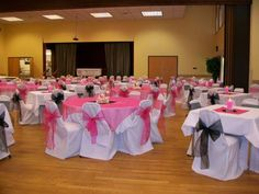 white banquet chair covers, black and pink organza sashes with pink organza overlays