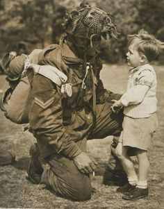 A British paratrooper greets a small boy, 1944. (Photo: National Army Museum/UK)