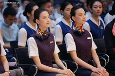 Twin sisters in uniforms attend a graduation ceremony in the Civil Aviation University of China (CAUC), in north China's Tianjin, June 2017.