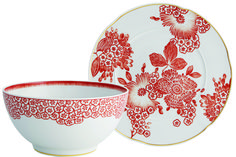 Fashion Plate - Inspired by floral motifs on a dress designed for Vogue magazine in 2006, the new Oscar de la Renta Coralina Collection brings haute couture to the table. Style-laden settings are a snap with this exuberant, bloom-bedecked tableware, including assorted plates, bowls, teacups, teapot, creamer and sugar.