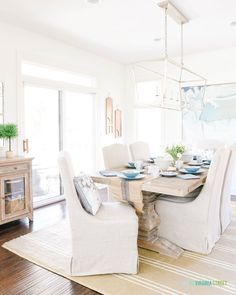 Dining area with Darlana light pendant, fabric covered dining chairs, striped jute rug, and Easter tablescape. Decor, French Country Dining, Home, Dining Room Design, Block Printed Pillows, Country Farmhouse Decor, Minimalist Bedroom, Spring Home, House Tours