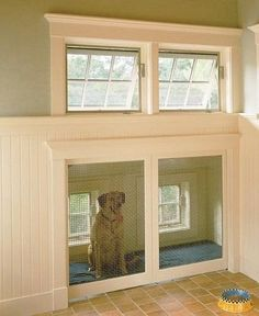 Built-in dog house with doggie door to outside- add it to the blue prints!