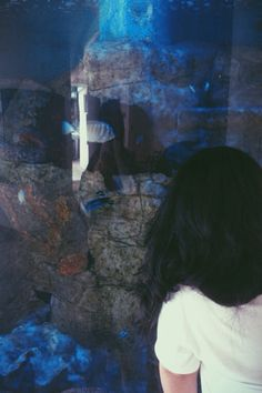 Me being engrossed on them fishes but yeah, my messy thick hair ruined it.
