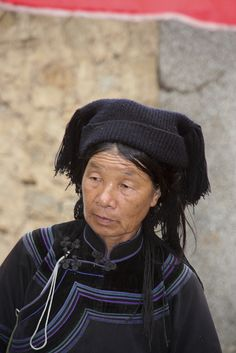 There are 56 Chinese minority - China Xinjienzhen - Black Hmong woman by jadis1958, via Flickr