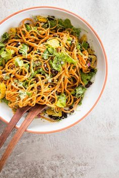 Are you looking for the best cold salad for summer? Try this southwest sweet potato noodle salad! It packs a bunch of flavors into one bowl, and the avocado pesto dressing is out of this world! This is the only healthy, clean eating, vegan summer recipe you need this year - easy, a little spicy and packed with fiber from the black beans, corn and baby kale. | #recipe #easyrecipes #salad #summer #sidedish #bbq #lunch #lunchideas