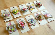 https://flic.kr/p/661w2k   Paper Mache Brooches   Handmade flower brooches.