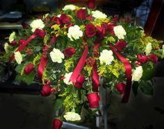 This casket spray as a mixture of roses, carnations and filler flowers, a lush amount of beautiful greenery and accented with satin ribbon. Funeral Sprays, Casket Sprays, Memorial Flowers, Funeral Arrangements, Winter Rose, Carnations, Ribbons, Red Roses, Lush