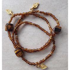 Tigers Eye gemstone seed bead matte gold leaf paisley charm stretch... (€16) ❤ liked on Polyvore featuring jewelry, bracelets, gem jewelry, leaf charm, gemstone bangle, handcrafted gemstone jewelry and 24k jewelry