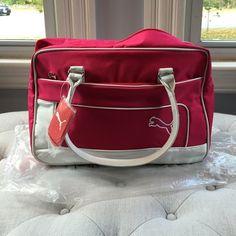 NWT Puma bag NWT fuchsia Puma bag. Excellent bag with zipper top and zipper front pocket. Puma Bags