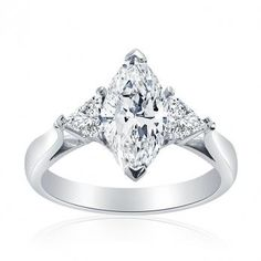 Marquise Diamond Engagement Ring with Trilliant Diamonds.  This is so close to my ring!