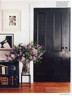 Black door, white wall.
