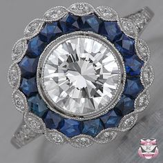 Vintage Engagement Ring -- I love this. It's unique and classic.