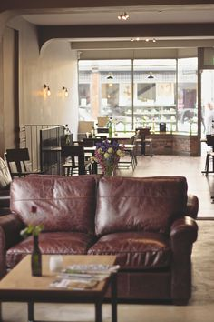Downstairs in @cellardoorhfd Stylish Bistro Restaurant Interiors #polishedconcrete #leathersofa #restaurantdesign