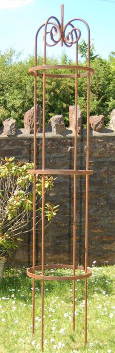 Scroll Top Classic Garden Obelisks in wrought iron.