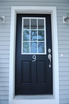 Black door with white trim and glass