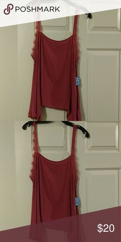 FREE PEOPLE INTIMATELY SLIP TANK Free People intimately slip tank. Could be worn for sleeping or out. It has beautiful lace around straps and goes down around underarm. A beautiful rose color. NWT Free People Intimates & Sleepwear Chemises & Slips