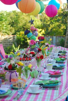 Pink stripes, colorful hanging lanterns, and cheerful flowers...Garden Party perfection!