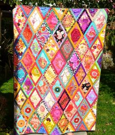 Kaffe Fasset bordered diamonds quilt...no instructions, but easy pattern to do and look at all the colors!