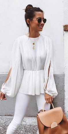 stylish look white blouse skinny pants backpack