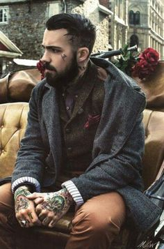 Dapper suit with beard and tattoos.. You can take me on a carriage ride anytime!