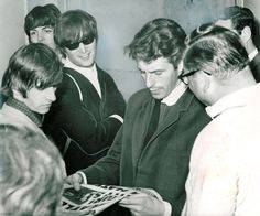 Derek Taylor (centre) was The Beatles' press officer and friend. He and John were particularly close, and wrote to each other often.