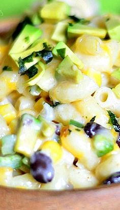 Tex Mex Mac and Cheese _ Wonderful meatless comfort dinner that's easy and packed with flavor. This is baked mac and cheese made with corn, black beans, jalapeno, avocado and variety of cheeses!