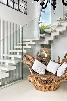 an inviting free form, teak root chair in a decidedly modern setting contemporary decor, contemporary furniture, Exclusive Design, Designer Furniture, Interior Design, Best decor, Decorating secrets, entrance hall,living area.   get inspired on: http://www.bocadolobo.com/en/inspiration-and-ideas/