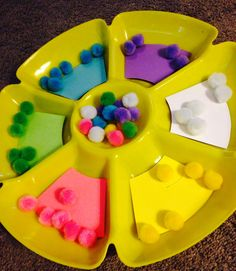Cheap DIY color sorting game:  Sectioned veggie tray from Thrift Store- .99 cents   Colored paper- on hand  pompoms- $1 for multicolor bag  DIY Toddler Activity