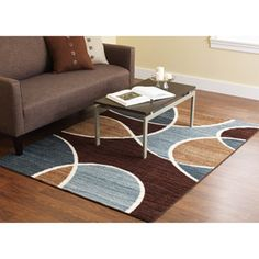 $69.96 like the blue along with the chocolate brown...think we'll get this one if our new place has hardwood floors