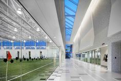 Image 9 of 29 from gallery of Brampton Soccer Centre / MacLennan Jaunkalns Miller Architects. Photograph by Tom Arban Soccer Center, Gym Center, Centre, Football Pitch, Football Stadiums, Football Field, Indoor Soccer Field, Indoor Tennis, Halle