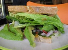 At the Sprout House Natural Foods Market in Grosse Pointe Park, the popular Southwestern Avocado sandwich overflows with fresh organic ingredients: many slices of avocado, Romaine lettuce, chopped red onion, sun-dried tomato and bright green cilantro puree on farm bread.