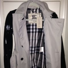 Authentic Burberry Trench with Patent Leather Gorgeous Trench with a edge.  Classic Burberry Trench with Patent Sleeves and pocket detail.  BRAND NEW!!! Burberry Jackets & Coats