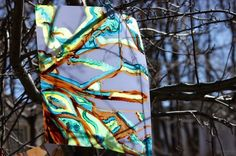 Painting using tree branches to anchor paper-ThinkinEd - thinkined.com blog