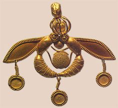 The Minoan Bee was found in the Old Palace cemetery at Chrysolakkos, outside the Palace of Malia, the 3rd largest Minoan Palace on the island of Crete (after Knossos and Pheastos), in Greece. It dates back to the Bronze Age during the Protopalatial Period (1800 - 1700 BC). This is very detailed representation of two bees carrying a drop of honey to their honeycomb. The two bees flank the drop of honey at center in perfect symmetry.