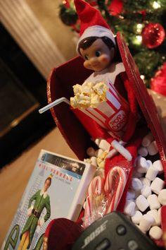 elf on a shelf : watching the movie Elf