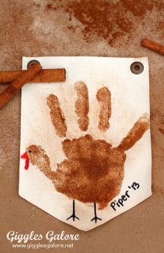 Make a sugar and spice handprint turkey banner this Thanksgiving for a fun, sweet smelling and memorable way to remember those tiny little handprints. #ad #thanksgiving #kidscraft #thanksgivingcraft #diy #craft #gigglesgalore #gigglesgalorecreates #holidaycrafts