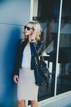 Black moto jacket, white tank, blush pencil skirt, and black handbag