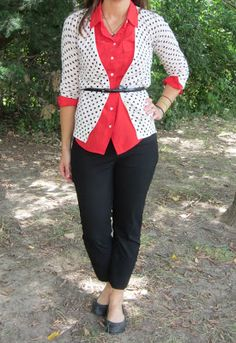 polka dot cardigan belted over red blouse, black ankle pants